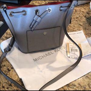 "Small gray Michael Kors ""bucket"" crossbody bag."